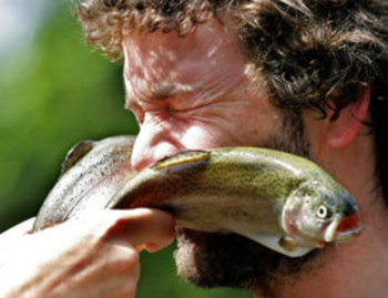 Photo of guy being slapped round the chops by wet fish. Doncha wish it was Thom Yorke?